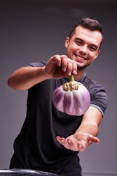 The concept of agriculture. Eggplant in male hands. Healthy Eating.