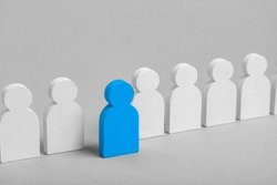 The concept of an initiative employee is leader. From the crowd of white men came out one blue leader