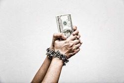 The concept of Anti-Corruption / hands of a businessman holding dollar bank with a chain lock on his hands on a white background.