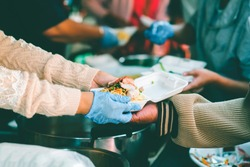 The concept of begging food : Hands of the poor are waiting for food donations to alleviate hunger