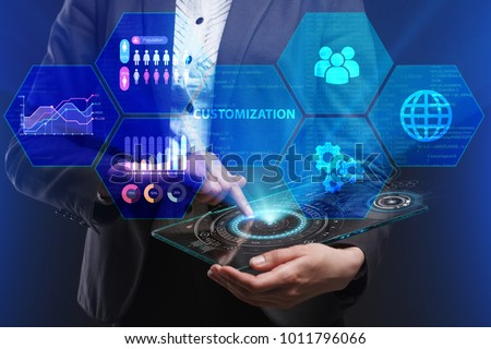The concept of business, technology, the Internet and the network. A young entrepreneur working on a virtual screen of the future and sees the inscription: Customization ストックフォト ©