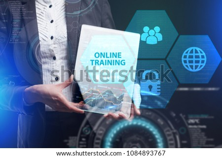 The concept of business, technology, the Internet and the network. A young entrepreneur working on a virtual screen of the future and sees the inscription: Online training