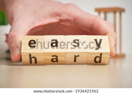 The concept of changing the degree of difficulty is easy and hard on wooden cubes. Foto d'archivio ©