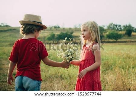 The concept of child friendship and kindness. Sweet angel children. Child care. Romantic and love. Human emotions - kids first love. Summer portrait of happy cute children Photo stock ©
