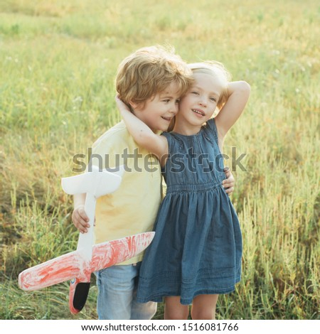 The concept of child kindness and childhood. Childhood memories. Active children concept. Cute children walking in the wheat golden field on a sunny summer day #1516081766