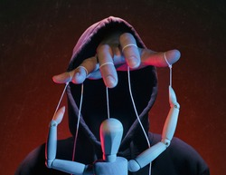 The concept of extortion, blackmail. Man in a hoodie and a puppet.