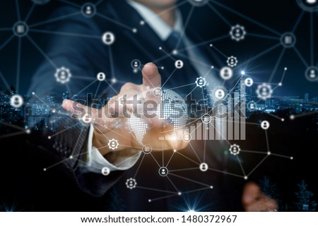 The concept of global communication in business. Businessman working on virtual screen in the network.