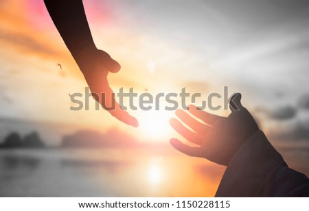 The concept of God's salvation:silhouette of helping hand concept and international day of peace #1150228115