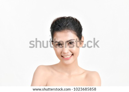 The concept of healthy beautiful woman. Beautiful women keep healthy. Beautiful woman smiling with happiness. Beauty Asian girl with beauty skin and clear white. #1023685858