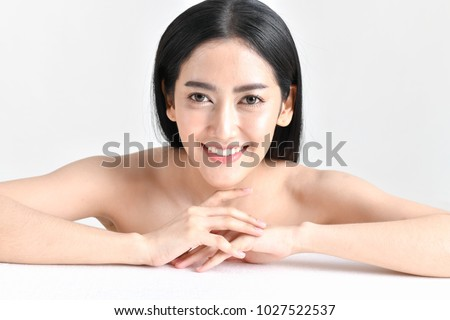 The concept of healthy beautiful woman. Beautiful women keep healthy. Beautiful woman smiling with happiness. Beautiful Asian girl with beauty skin and clear white. #1027522537
