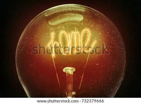 The concept of home comfort, family happiness. Filament light bulb in the shape of the word home. An excellent choice for the design of postcards.