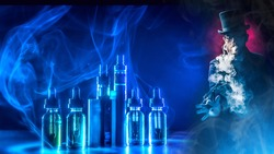 The concept of hovering on a dark background. Electronic cigarettes and liquids. A man smokes an electronic cigarette against the background of vaping accessories. VAPE shop.