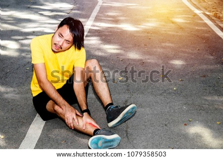 47f0814c0b The concept of injury while exercising : sport man helping his friend  having leg cramp in