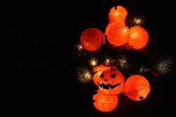 The concept of light on the night Halloween.Round lamp shape of pumpkin used to decorate with copy space for text.