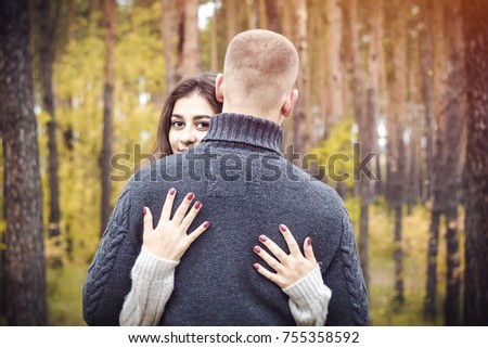 The concept of love. A pair of lovers. Girl and boyfriend embracing in nature