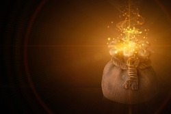 The concept of magical power to achieve wealth. money bag. flash of light and magical particles on a dark background