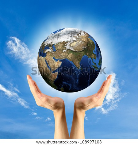 The concept of protecting the world. - stock photo