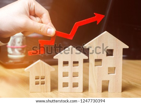 The concept of real estate market growth. The increase in housing prices. Rising prices for utilities. Increased interest in mortgage and rising interest rates on mortgages. focus on the house