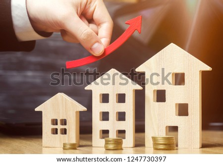 The concept of real estate market growth. The increase in housing prices. Rising prices for utilities. Increased interest in mortgage and rising interest rates on mortgages. Rent increase. Agent