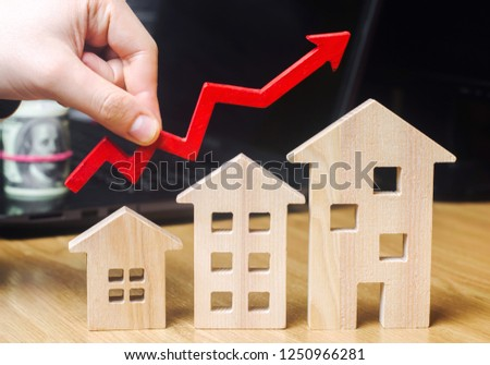 The concept of real estate market growth. The increase in housing prices. Rising prices for utilities. Increased interest in mortgage and rising interest rates on mortgages. selective focus