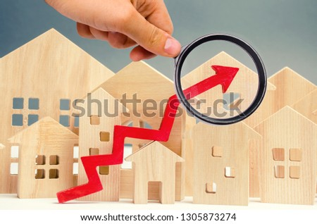 The concept of real estate market growth. The increase in housing prices. Rising prices for utilities. Increased interest in mortgage and rising interest rates on mortgages. Rent increase. Dollars