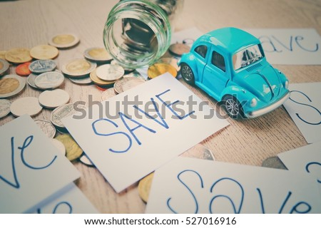 The concept of saving money. Saving money on travel. Saving money to buy a dream car. To save money on car repairs. Toy cars and composing artificial light. Retro and vintage style. #527016916