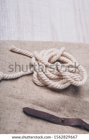 the concept of sewing accessories: a coil of rope. women's clothing accessory close up