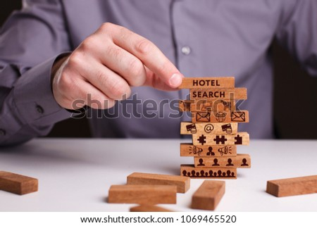 The concept of technology, the Internet and the network. Businessman shows a working model of business: Hotel search #1069465520
