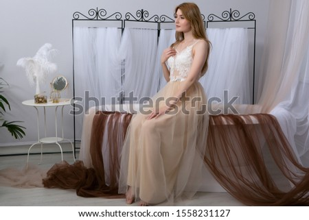 The concept of tenderness and sensuality. Beautiful model posing in the bathroom in a sexy negligee. Sensual Portrait of a young woman. #1558231127