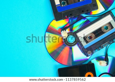 The concept of the evolution of music. Music cassette, CD-disk, mp3 player. Vintage and modernity. Music support. Background music. Record musician.