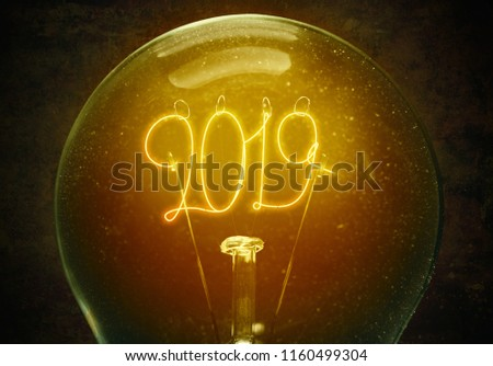 The concept of the new 2019 year. Filament lamp with numbers 2019. Cozy image. Hygge  mood