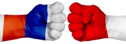 The concept of the struggle of peoples. Two hands are clenched into fists and are located opposite each other. Hands painted in the colors of the flags of the countries. Russia vs Poland