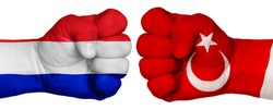 The concept of the struggle of peoples. Two hands are clenched into fists and are located opposite each other. Hands painted in the colors of the flags of the countries. France vs Turkey