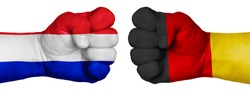 The concept of the struggle of peoples. Two hands are clenched into fists and are located opposite each other. Hands painted in the colors of the flags of the countries. France vs Germany