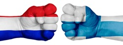 The concept of the struggle of peoples. Two hands are clenched into fists and are located opposite each other. Hands painted in the colors of the flags of the countries. France vs Finland
