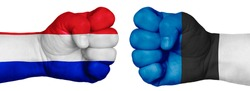 The concept of the struggle of peoples. Two hands are clenched into fists and are located opposite each other. Hands painted in the colors of the flags of the countries. France vs Estonia