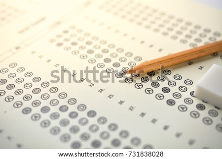 The concept of this image is a device for taking the test by writing the correct answer in the correct answer paper. #731838028