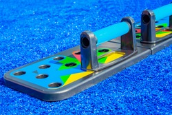 The concept of tools and equipment for sports - fitness tool push up on blue background .Close-up, space for your design, copy space .