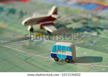 The concept of trip for a travel company. toy bus and plane on the map. To travel by plane. Choose a country to fly. Tourist destination. Road map with the little car. trip planning