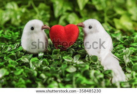The concept of Valentine's Day two little white bird the lovers, heart on the background of nature. #358485230
