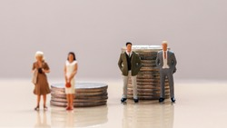 The concept of wage discrimination between men and women.