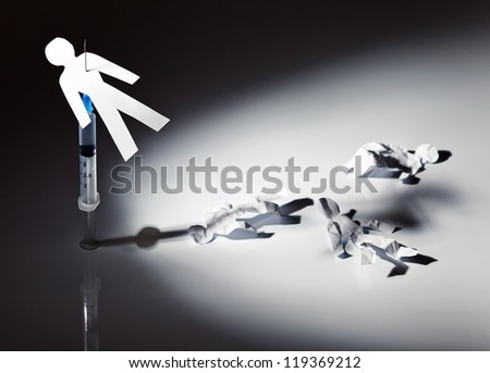 The conceptual image on a theme of narcotic dependence, a white reflective background.