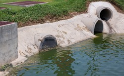 The concrete circular run-off pipe discharging water,Thailand