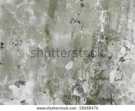 The concrete dirty green wall with stains and cracks - a background - stock photo