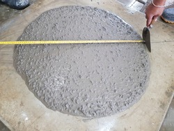The concrete slump flow test checking in lab to determine work-ability of fresh concrete