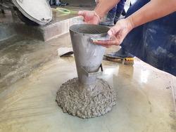 The concrete slump test checking in lab to determine work-ability of fresh concrete