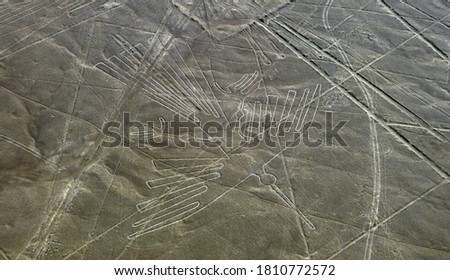 The Condor bird Nasca Geoglyph. Mysterious ancient lines Nazca in desert, Peru. Lines and geoglyphs of Nasca are series of drawings etched into ground surface of Pampas of Peru. Nazca culture.