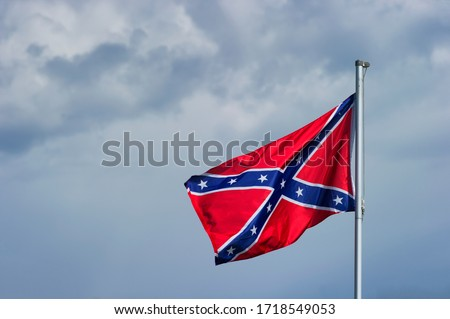 The confederate flag symbolized the government of eleven southern states seperate from the union.  This came to an end after the civil war was lost by the confederate states. Сток-фото ©