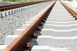 The construction of a railway line for a tram with rails, gravel and underlay sleepers / New Rails