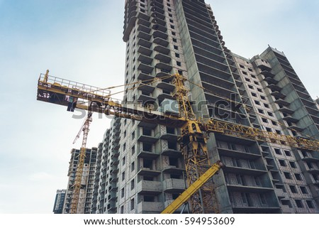 The construction of modern high-rise buildings with crane, Voronezh cityscape #594953609